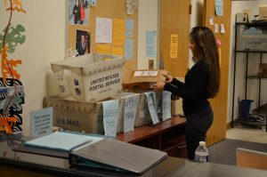 Sorting packages at the RHO. Photo: Saman Asdjodi/Georgetown Voice