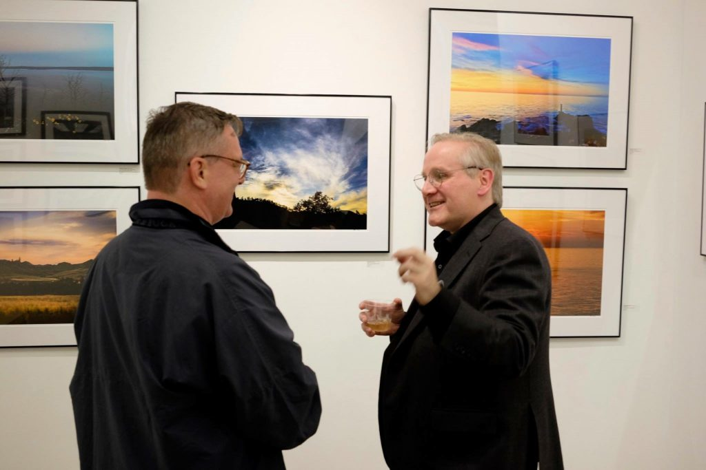 "Peter McCutchen (right) speaking about his latest exhibit, ""The Quality of Light,"" available at the Touchstone Gallery till Sunday November 1st."