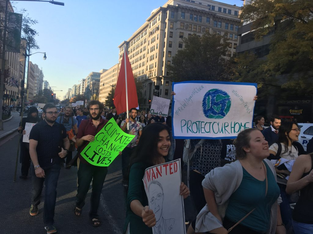 Students march to protest Trump EPA appointment