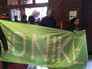 Students bring a banner from the rally in Dalhgren Quad to the President's foyer. Photo: Lilah Burke