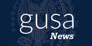"The words ""GUSA News"" on the Georgetown seal"
