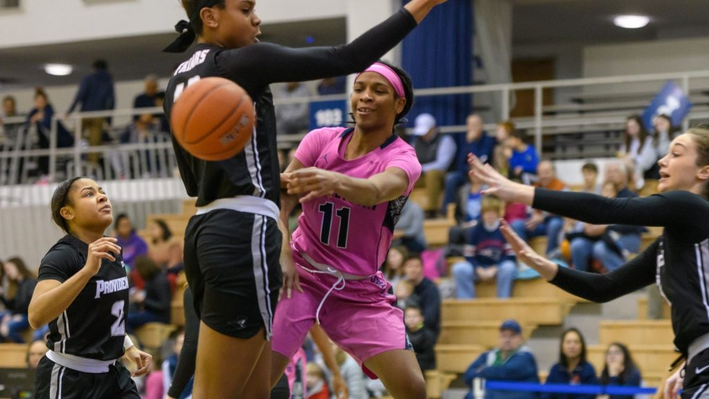 Women's Basketball Marches on to Elite Eight Behind White and Adomako