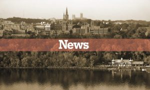 "A shot of Georgetown's skyline from the potomac river is covered with a banner reading ""News"""