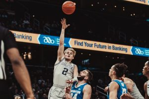 Mac McClung of the Georgetown Hoyas shoots a jump shot in a game against the Creighton Bluejays.