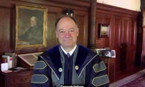 University President John DeGioia speaks to graduates via video.