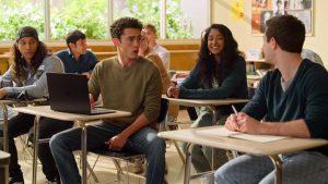 Devi (Maitreyi Ramakrishnan) sits in class with love-interest Paxton (Darren Barnet) and rival Ben (Jaren Lewison)