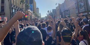 A sea of raised fists on a Los Angeles street during a Black Lives Matter Protest.