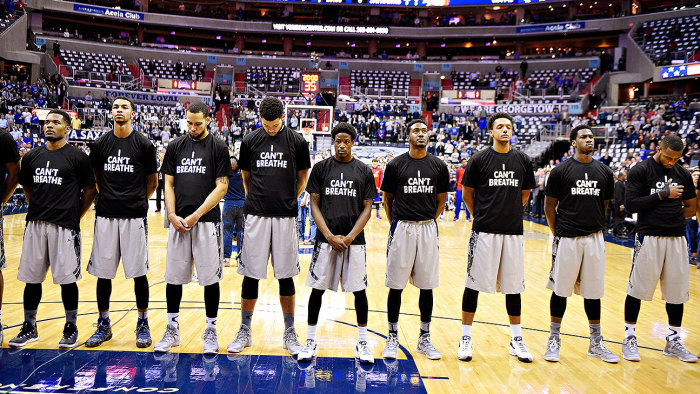 "Members of the 2014-15 Georgetown men's basketball team wear ""I Can't Breathe"" shirts after the murder of Eric Garner by NYPD."