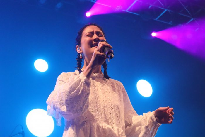 Michelle Zauner in a white dress singing at the Fillmore Silver Spring on July 21.